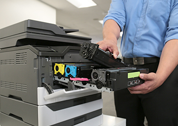 Man changing toner from printer