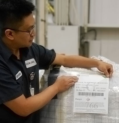 Lexmark employee adding manufacturing label