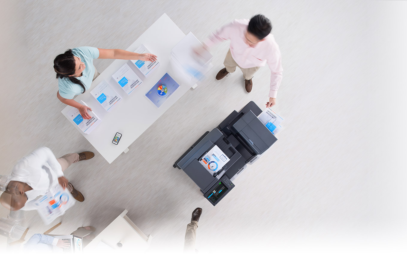 overhead view of office printer and office workers